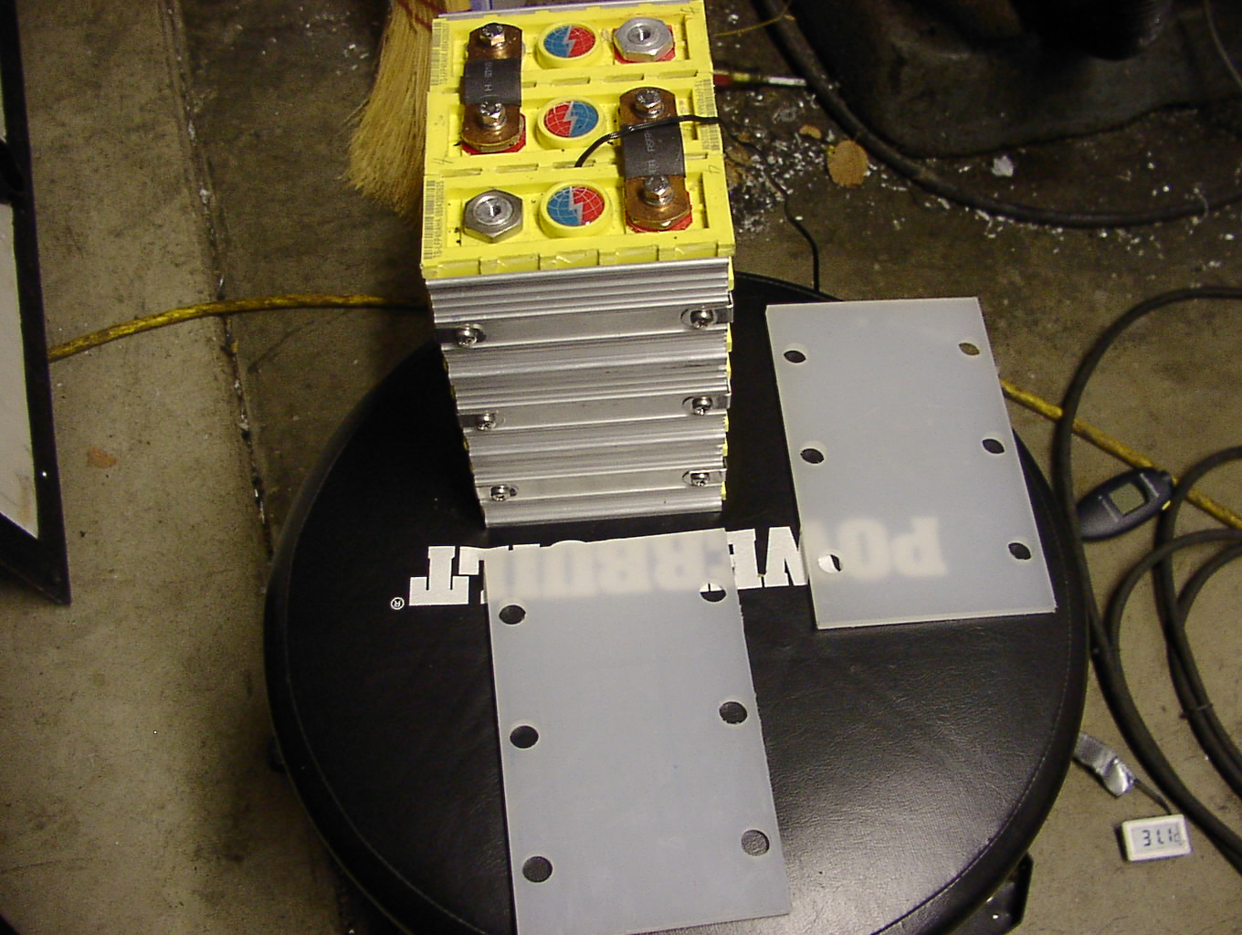 The plastic panels are machined. Now it's time to see how few nicads can be removed to fit the 3 Thundersky cells in.